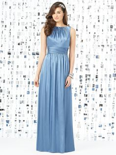 Dessy Social Bridesmaids 8145 Dress. This sleeveless full-length gown is simple yet flattering in silky soft Stretch Charmeuse. The bodice features a high neckline that accents gentle ruching. A wide band of ruched charmeuse cinches the waistline to lovely effect. The dress has a charming scoop back. The long shirred skirt flows luxuriously to the ground, creating an impression of soft mellowness.