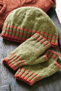 Striped knitted hat and matching fingerless gloves. Shop this knitting pattern at The Knitting Network now