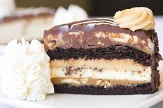 Reese's® Peanut Butter Chocolate Cake Cheesecake: Delicious chunks of Reese's® Peanut Butter Cups in our Original Cheesecake with layers of moist  fudge cake and smooth caramel.
