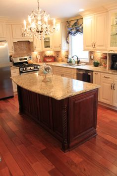 "Updated Kitchen, Updated kitchen with vanilla maple glazed cabinets, center island in cherry,  4"" molding, crystal chandeliers and a ""sea"" o..."
