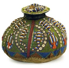 Africa | A Yoruba style beadwork and cowrie shell storage jar with cover from Nigeria | Late 20th century