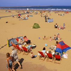 Adults and children a like enjoying the beautiful summer sunshine at Sandhaven Beach, South Shields. South Tyneside.