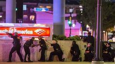 http://atvnetworks.com/index.html Dallas police officers take cover Thursday night after snipers ambushed cops during a demonstration organized to protest this week's police-involved shootings in Minnesota and Louisiana. (AP)