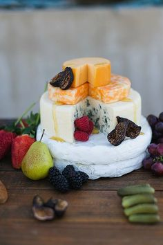 """The wedding cake is a ceremony staple. But if frosting isn't your thing? Don't abandon the indulgence; here are eight amazing cheese wheel cakes to inspire your own savory """"dessert."""""""