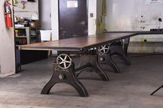 Hure Crank Conference Table with a 16' reclaimed boxcar oak top by Vintage Industrial Furniture