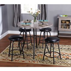 @Overstock - Simple Living Seneca Black/ Grey Adjustable Height 5-piece Dining Set - The Seneca five-piece set is a versatile dining piece that can be adjusted from counter to bar height. With a unique black metal base, this round dining table features a reclaimed look grey table top and comes with four comfortable upholstered stools.  http://www.overstock.com/Home-Garden/Simple-Living-Seneca-Black-Grey-Adjustable-Height-5-piece-Dining-Set/8789982/product.html?CID=214117 $334.99
