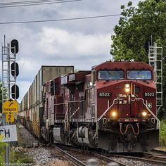 A trio of CP GEVOs lead an intermodal train through Dorval. The train is switching to the North track before entering CP's Lachine Intermodal Yard.  Railway Canadian Pacific  Train ID CP118  Locomotive(s) #CP8522 AC44CW #CP8770 ES44AC & #CP8730 ES44AC  Location Dorval Quebec Canada  Date June 29 2015  #CanadianRailway #RailwaysOfCanada #train_nerds #trains_worldwide #railfan #rail_barons #locos_of_america #north_american_rail_pictures #splendid_transport #daily_crossing  #instalogistics…
