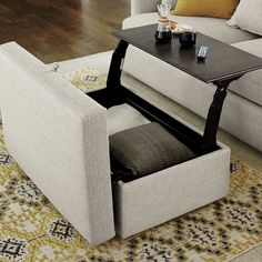 There's a reason it's called Lounge. This ottoman, part of our ultimate family room collection, goes to the next level with a pull-out tray nestled within.
