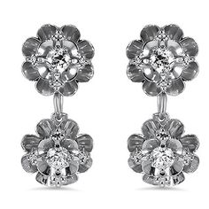 The Brokeshire Earrings from Brilliant Earth, Two gleaming precious metal flowers feature stunning diamond buds in each of these enchanting and feminine earrings from the Retro era (approx. 0.40 total carat weight).
