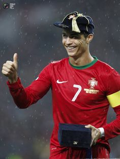 Portugal's Cristiano Ronaldo gestures as he celebrates his 100th cap for the national team before their 2014 World Cup qualifying soccer match against Northern Ireland at the Dragon stadium in Porto