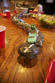 """I have a feeling there is a """"Cars"""" party in my near future. McQueen Cupcake Road Cake"""