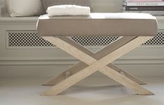 The elegant cross legged frame of the Alex Stool combines traditional design with a crisp tailored cushion