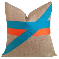 Eco-friendly burlap pillow with turquoise and orange fabric striping. Made in the USA.   Product: PillowConstruction...