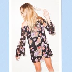 Summery Black Floral Dress A gorgeous light black floral dress perfect for spring and summer! Features an open back. Size small and brand new from Cotton Candy. It has long sleeves that gives it a boho look and is fully lined. Cotton Candy Dresses