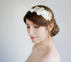Bridal flower hair accessory in Ivory champagne, wedding floral headpiece, white flower crown made of satin and pearls. $52.00, via Etsy.