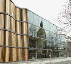 Parking garage exterior wrapped with bamboo poles | Leipzig | HPP
