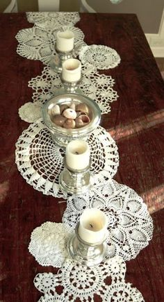 Display of candles on crochet lace doilies