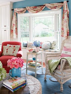 Light and Airy  A mix of wicker and upholstered furniture keeps the room soft, yet casual. A large bay window lets in lots of natural light and is dressed simply with floral-print swag.