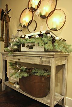 Use an old suitcase and washtub filled with pine bows and ornaments for a Christmas table display