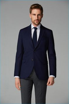 Pairing a deep blue sport coat and charcoal suit pants will create a powerful and confident silhouette.   Shop this look on Lookastic: https://lookastic.com/men/looks/navy-blazer-white-dress-shirt-charcoal-dress-pants/19930   — White Dress Shirt  — Navy Knit Tie  — Navy Blazer  — Charcoal Dress Pants