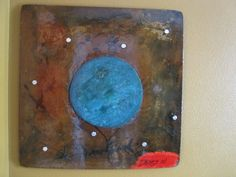 recycled items made into wall art