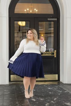 Chicago Plus Size Fashion Blogger Natalie Craig reviews Eloquii's Pleated Midi Skirt in the color Sky Captain and Eloquii's Bell Sleeve Sweater with Trim in White.