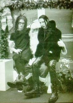 Marilyn Manson and Twiggy Ramirez on Santa's knee