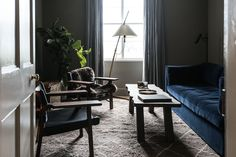 Dark, rich colours and a blue velvet sofa at enchanting Killiehuntly farmhouse…