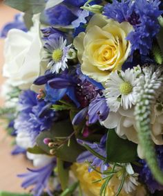 Delphinium, Blue Cornflowers, White Monte Casino Asters, Scilla, Muscari, Eucalyptus and Rosemary,