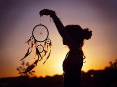 Sunset girl with dreamcatcher