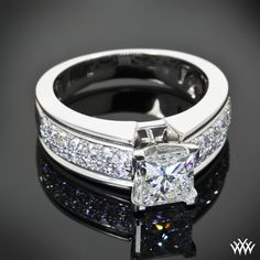 """This beautiful """"Fiotto"""" Diamond Engagement Ring features 0.50ctw of Round-Ideal Diamond Melee in dual rows. The V-Tip 4 prong head holds a brilliant 1.30ct Princess Cut Diamond"""