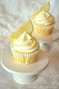 Limoncello Cupcakes Don't these just look absolutely dreamy? These are lemon cupcakes with lemon curd Lemon Curd Dessert, Lemon Desserts, Lemon Recipes, Just Desserts, Sweet Recipes, Delicious Desserts, Yummy Food, Cupcake Recipes, Cupcake Cakes