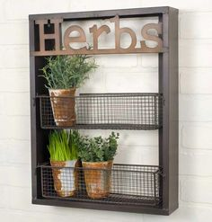 "Use this wall hanging in a garden for herbs or kitchen for spices. Hangs with two holes on the back. Details: 15"" W X 3 1/2"" D X 20"" T"