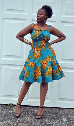 A skinny strap sun dress in a modernised bold African print in blue and mustard hues. It has smocking at the waist and back giving a snug fit and flattering silhouette. One size fits most. Latest Ankara Dresses, Ankara Short Gown, Ankara Dress Styles, Latest African Fashion Dresses, African Print Dresses, African Print Fashion, African Dress, Short Dresses, Ankara Fashion