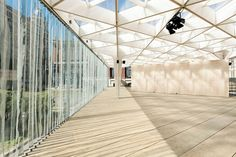 The whole structure consists of a base and terrace, the premises, pillars and a roofed area.