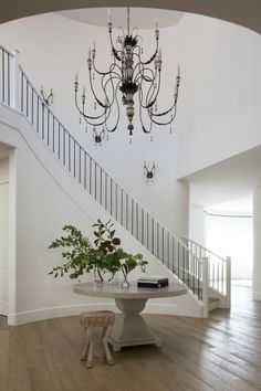 Entry with French country chandelier and wrought iron staircase - Jaimee Rose Interiors. White Farmhouse Exterior, Modern Farmhouse Decor, Modern French Country, French Country Decorating, French Style, French Country Chandelier, Wrought Iron Staircase, White Marble Bathrooms, Rustic Luxe