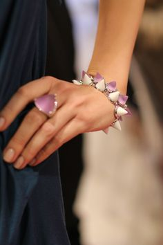My two favorite pieces from Eddie Borgo's SS12 line, the white and lavender cone braclets. This is obsession level.