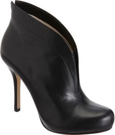 """$365.00 Exclusively Ours! Designed with an extended back and sides that frame your feet, this smooth calfskin leather round toe bootie is detailed with a center seam, tonal topstitching and an elastic gore at the vamp. Hidden platform. Approximately 4.25"""" heel (110mm), 15mm platform Leather sole Available in Black Imported"""
