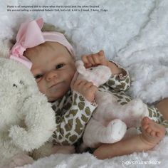 Coco-Malu by Elisa Marx is a vinyl reborn doll kit that comes with a sculpted head, 3/4 arms, full legs, and a certificate of authenticity. Coco-Malu will measure approximately nineteen inches long when finished. We recommend our 504 body to go with this doll kit.