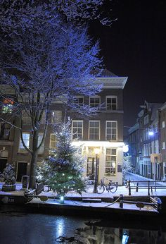 """amsterdam cafe on a canal on a snowy night - I asked my son if he had tried the cafes or the coffee houses.  He said, """"Yes."""""""