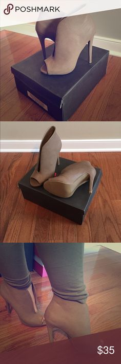 """Taupe Peep Toe Vamp Heel NEVER WORN!!! These heels are sexy! Peep toe, wide open vamp heel. Faux embossed snake detail. Heel height 5"""". Perfect for girls night out or a hot date! Pairs well with dresses or jeans. (Only tried on for photo, otherwise never worn) JustFab Shoes Heels"""