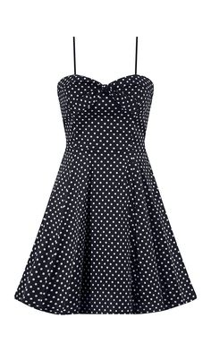 This full skirted style polka dot dress features a sweetheart bust with tie. The cut out open back detail adds a fun detail to this dress.