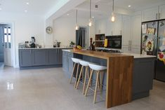 Love the wood mixed in; it creates a nice seperation between eating area and kitchen | 1920's Property Refurbishment Hertfordshire - contemporary - Kitchen - Other Metro - Studio 3 kitchens