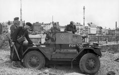 "German soldiers inspecting a captured British Daimler ""Dingo"". Dieppe. August 1942"