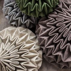 Cones is a series of poufs by Jule Waibel, a German designer now based in London.A continuation of Waibel's interest in pleated fabric, the collection plays upon the idea of unfolding a stone. Folding Structure, Supreme Furniture, Geometric Construction, Leather Stool, Fancy Houses, Tapestry Fabric, Pleated Fabric, Textiles, Fabric Manipulation