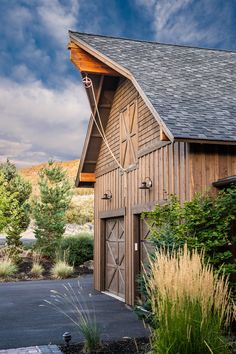 Artistic Barn Style Garage With Apartment Plans in Garage And Shed Rustic design ideas with Artistic bar doors barn style garage board and batten siding chimney hood circle