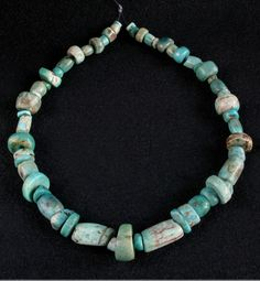Morocco | A strand of fifty-nine ancient amazonite beads from Morocco; Amazonite, along with natural amber and red coral, have been and still are considered the most important beads for the Maghreb and Mauritania traditional cultures. | 1,900$