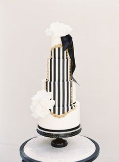 White, gold, and black striped Kate Spade wedding cake // inspiration,