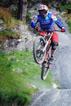 A Royal Air Force mountain biker with the RAF Cyclist Association Downhill Mountain Bike Team at Antur Stiniog North Wales in June 2013.