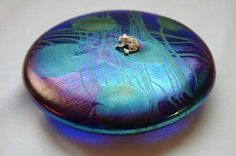 Fabulous lily pad with a tiny silver frog paperweight by John Ditchfield.